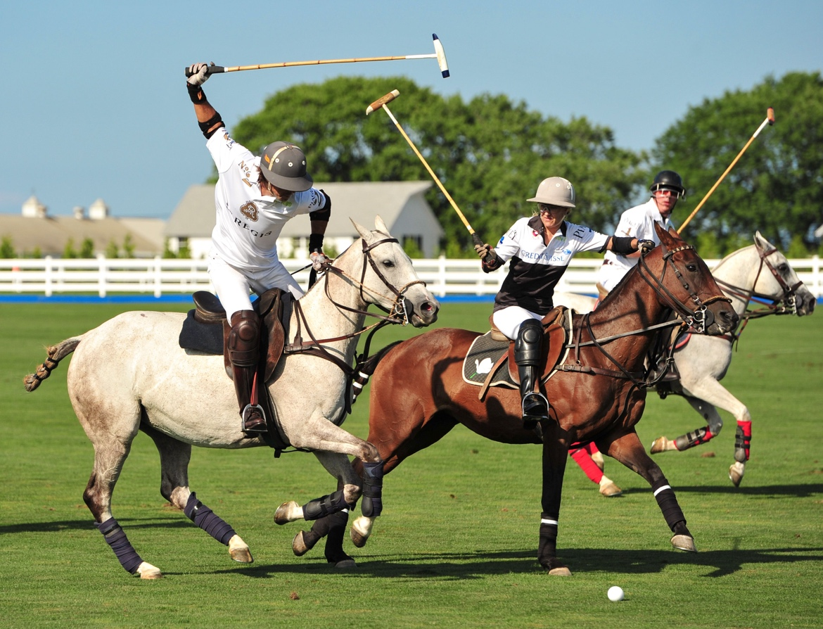 A group of men playing polo  Description automatically generated with medium confidence